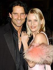 Nicollette Sheridan and husband