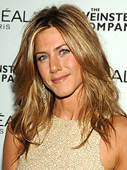 Photographer: Aniston 'Exposed Herself'