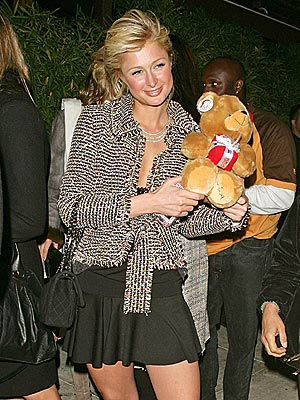 GRIN AND BEAR IT   photo | Paris Hilton