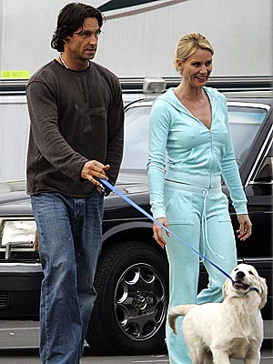 PUPPY MAKES THREE photo | Nicollette Sheridan