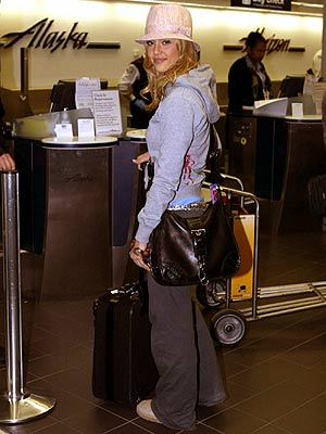 FREQUENT FLIER photo | Jessica Alba