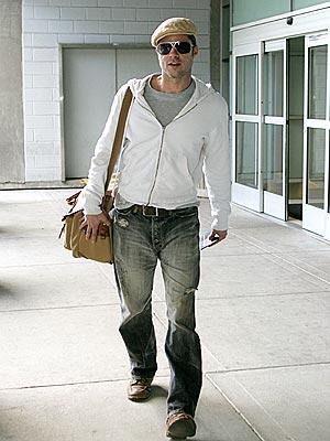 JETTING IN photo | Brad Pitt