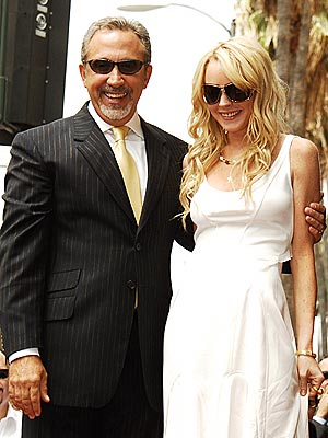 PAYING TRIBUTE photo | Emilio Estefan, Lindsay Lohan