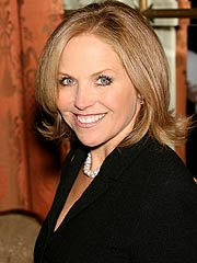 Suri Debuts with Katie Couric