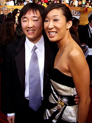 Photo of Sandra Oh & her Brother  Ray Oh