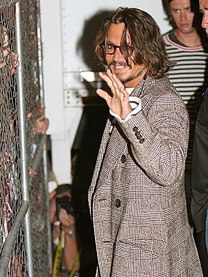ON THE FENCE? photo | Johnny Depp