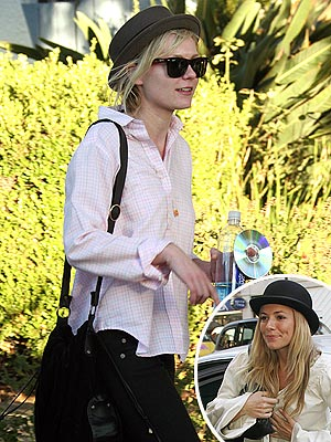 KEEPING A LID ON  photo | Kirsten Dunst