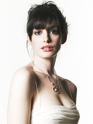 Anne Hathaway with her dark hair and eyes and fair skin has High Value