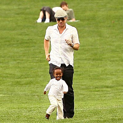 GIVING CHASE photo | Brad Pitt, Zahara Jolie-Pitt