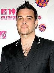 Singer Robbie Williams Checks Into Rehab