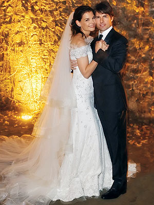 Which designer outfitted the bride and groom for their Nov. 18 Italian wedding? | Katie Holmes, Tom Cruise