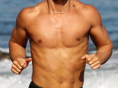 This beach-lover keeps our hearts pounding along with his workouts. He is: | Matthew McConaughey