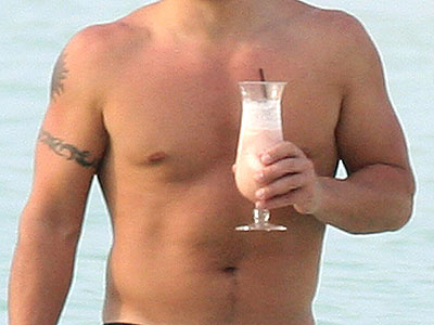 We forgive his girly drink, if only because we're distracted by his broad chest. He is: | Nick Lachey