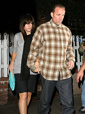HELPING HAND  photo | Jesse James, Sandra Bullock