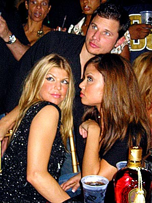 Vanessa, Nick, and Fergie snap flicks at a Pre-Superbowl Party in Miami.
