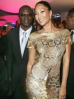 ALL THAT GLITTERS  photo | Djimon Hounsou, Kimora Lee Simmons