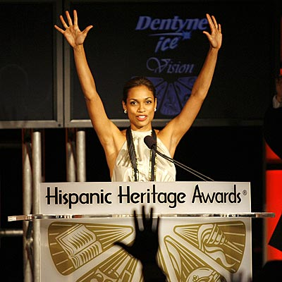 RAISE YOUR HANDS photo | Rosario Dawson