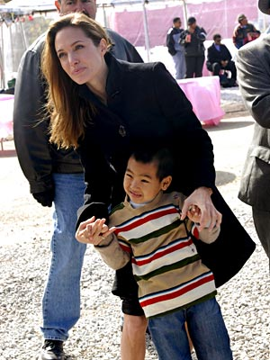 BUILDING SUPPORT photo | Angelina Jolie, Maddox Jolie-Pitt