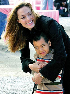 GOOD WORKS  photo | Angelina Jolie, Maddox Jolie-Pitt