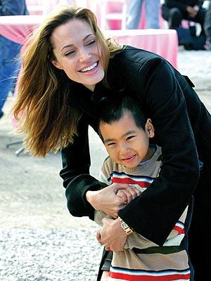 GOOD WORKS  photo | Angelina Jolie, Maddox Jolie-Pitt