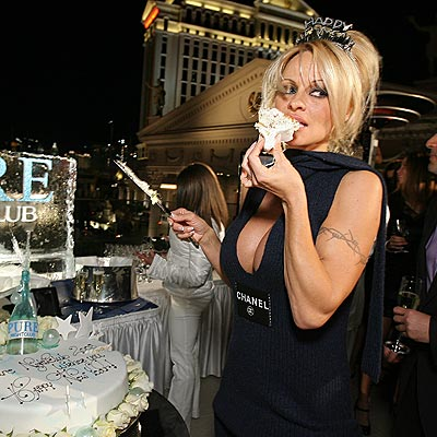 HAVING HER CAKE  photo | Pamela Anderson