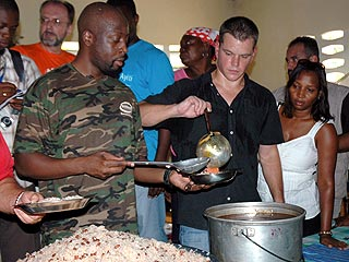 Matt Damon, Wyclef Jean Hand Out Food in Haiti | Matt Damon, Wyclef Jean