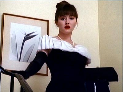 Who wore the same dress as Brenda Walsh at the spring dance?