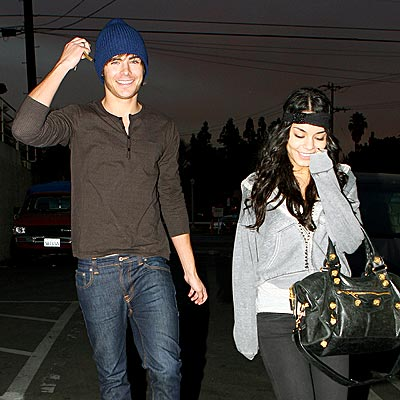 LAUGHING ALL THE WAY photo | Vanessa Hudgens, Zac Efron
