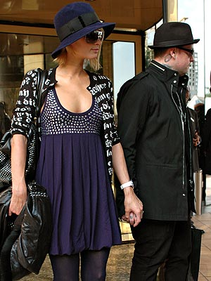 HELPING HANDS  photo | Benji Madden, Paris Hilton