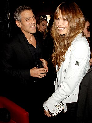 THE CHARMED ONE photo | Elle Macpherson, George Clooney
