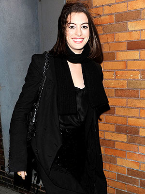 SWEPT AWAY  photo | Anne Hathaway