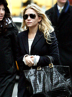HER BAG, BABY! photo | Ashley Olsen