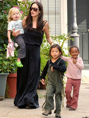 ANGELINA JOLIE&#39;S SHADES AND DRESS photo | Angelina Jolie