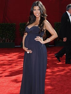 kourtney kardashian shows off her belly at the emmys