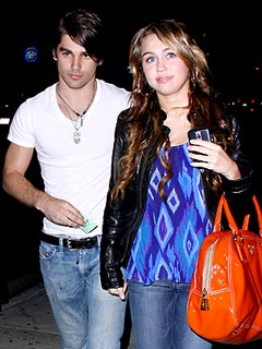 Miley Cyrus & Justin Gaston Split