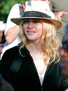 Madonna Lands in Malawi Amid Controversy