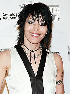 Hard Rocker Joan Jett Attends Ferret Homecoming Party