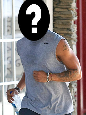 Who showed off his tattoo sleeve before going for a jog? | Ryan Phillippe