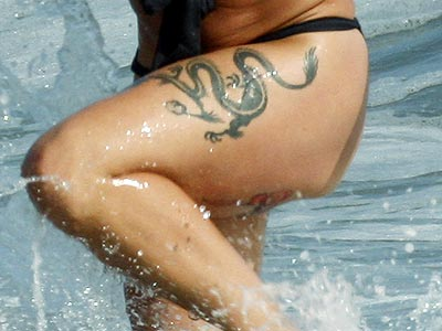 Which singer sports a dragon tattoo on her thigh? | Pink