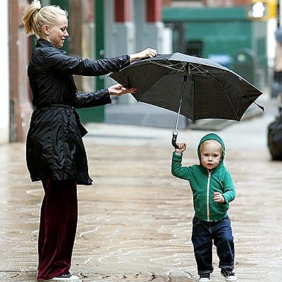 STROLLING IN THE RAIN photo | Naomi Watts