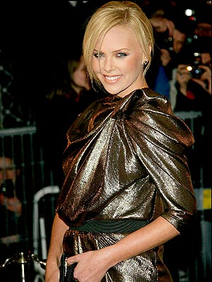 GOLD STANDARD photo | Charlize Theron