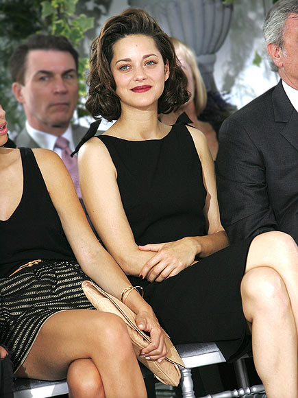 SITTING PRETTY photo | Marion Cotillard