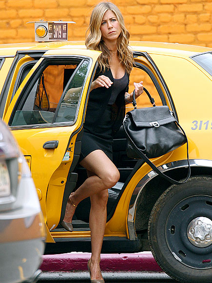 LEG UP photo | Jennifer Aniston
