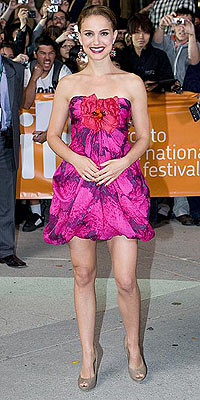 Natalie Portman is pretty in pink in her fuchsia dahlia-printed dress, matching earrings and nude peep-toes. Which piece is under $100? | Natalie Portman