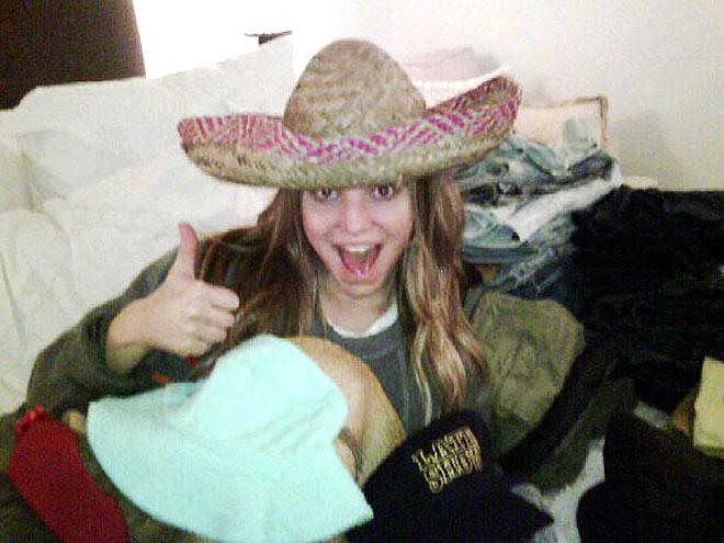 SHE WEARS MANY HATS photo | Jessica Simpson