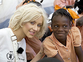 PHOTO: Christina Aguilera Feeds Haiti Refugees