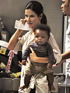 Sandra Bullock and Baby Louis Jet off from Austin