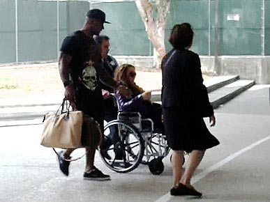 Mariah Carey's Diva Heels Land Her in a Wheelchair
