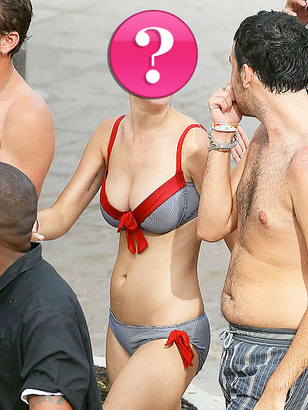 Who flaunted her curves in a flirty striped bikini?