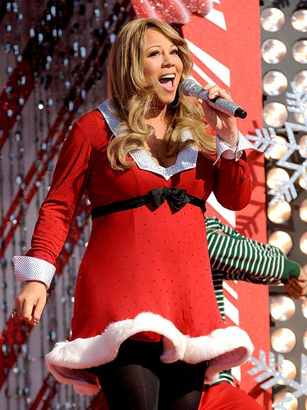 Where did Mariah Carey carol for the holidays?